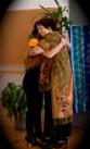 Kira embracing Kristy leaving stage